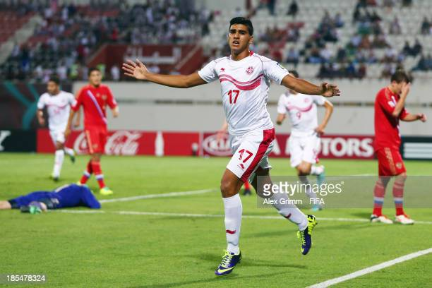 Maher Gabsi of Tunisia celebrates his team's first goal during the FIFA U17 World Cup UAE 2013 Group D match between Tunisia and Russia at Sharjah...