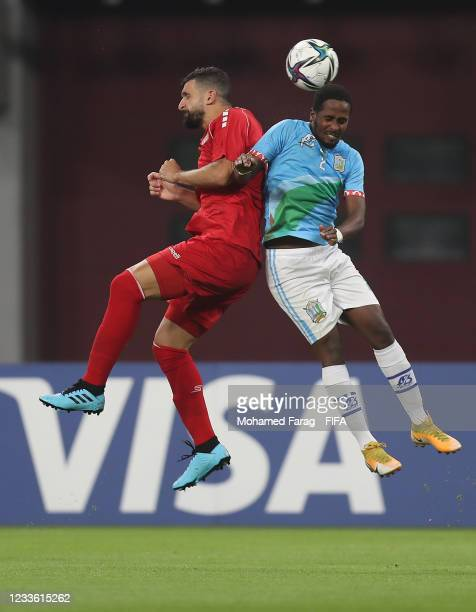Maher Sabra of Lebanon competes with Mohamed Bourhan of Djibouti during the FIFA Arab Cup 2021 Qualifying match between Lebanon and Djibouti at...