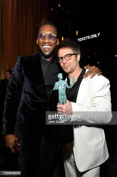 """Mahershala Ali and Sam Rockwell, winner for best actor award in a TV movie or television miniseries for """"Fosse/Verdon"""" pose in the trophy room during..."""