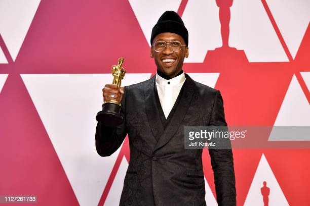 Mahershala Ali poses with the Best Supporting Actor award for Green Book in the press room during at Hollywood and Highland on February 24 2019 in...