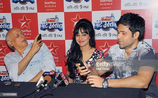 Mahesh Bhatt Emraan Hashmi and Neha Sharma on the sets of the reality show 'Chhote Ustad' in Mumbai on September 28 2010