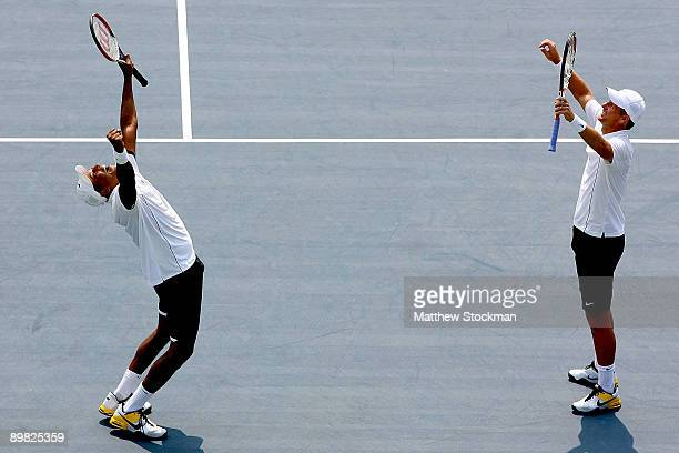 Mahesh Bhupathi of India and Mark Knowles of the Bahamas celebrate match point against Mix Mirnyi of Belarus and Andy Ram of Israel during the...