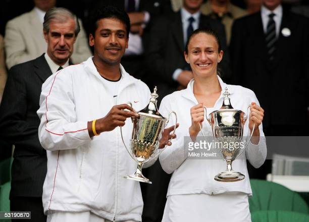 Mahesh Bhupathi of India and Mary Pierce of France celebrate with the trophy after they defeated Paul Hanley of Australia and Tatiana Perebiynis of...