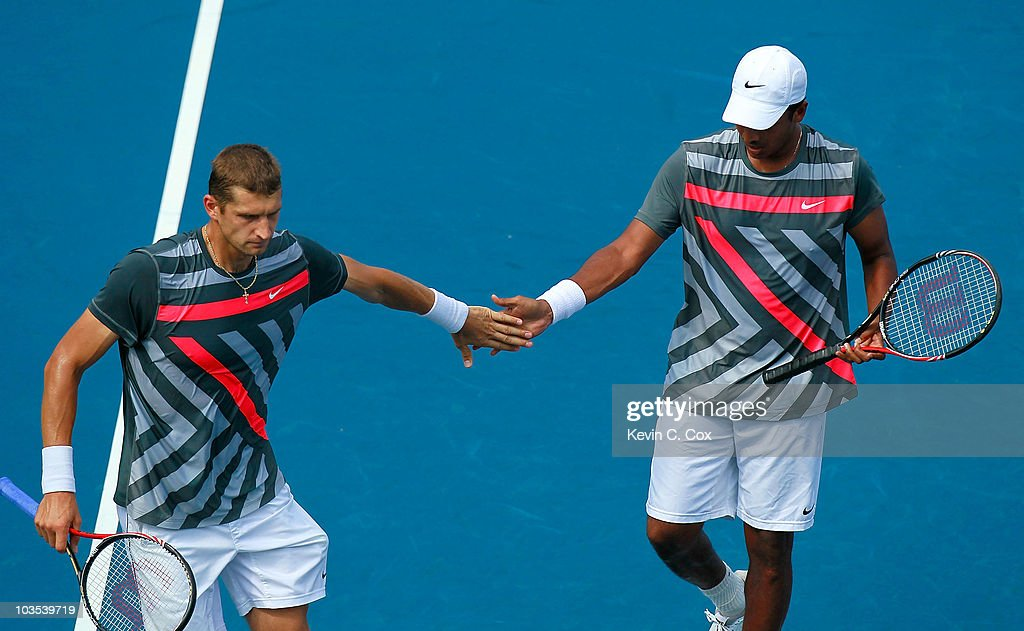 Mahesh Bhupathi of India and Max Mirnyi of Belarus react after winning a point over Bob and Mike Bryan during the finals on Day 7 of the Western & Southern Financial Group Masters at the Lindner Family Tennis Center on August 22, 2010 in Cincinnati, Ohio.