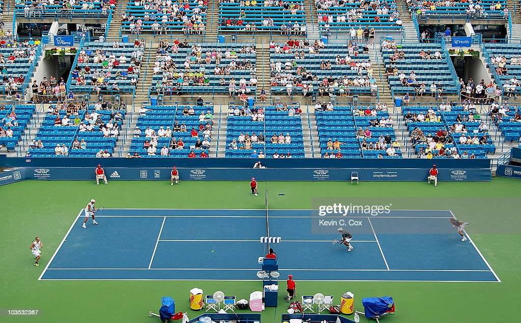 Mahesh Bhupathi of India and Max Mirnyi of Belarus serve to Lukasz Kubot of Poland and Oliver Marach of Austria in the semifinals on Day 6 of the Western & Southern Financial Group Masters at the Lindner Family Tennis Center on August 21, 2010 in Cincinnati, Ohio.