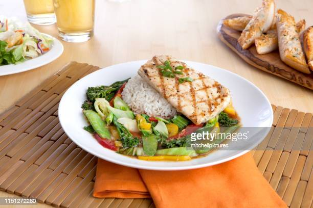mahi stir fry - dolphin fish stock pictures, royalty-free photos & images