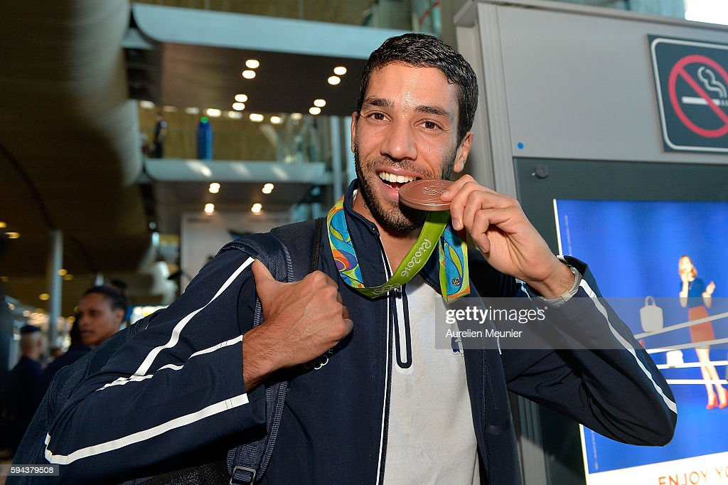 Mahiedine Mekhissi-Benabbad, 3000m steeplchase bronze medalist, arrives at Roissy Charles de Gaulle airport after the Olympic Games in Rio on August 23, 2016 in Paris, France. Team France finished seventh in the medal table at the Rio Olympics, with a total of 42 medals.