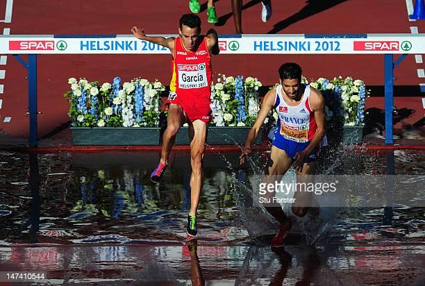 Mahiedine Mekhissi-Benabbad of France hurdles the water jump ahead of Victor Garcia of Spain on his way to victory in the Men's 3000 Metre...