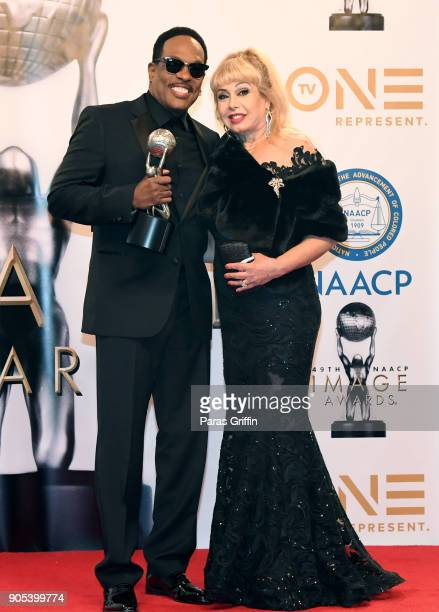 Mahin Wilson and Charlie Wilson recipient of the Music Makes a Difference Honor pose in the press room for the 49th NAACP Image Awards at Pasadena...