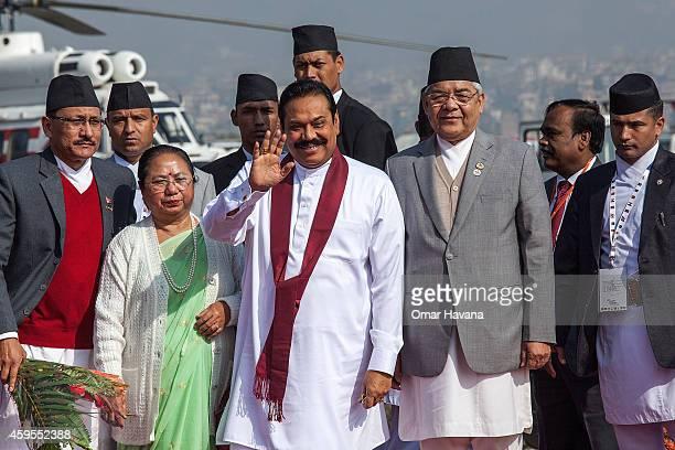 Mahinda Rajapaksa, President of Sri Lanka is greeted by the Deputy Prime Minister of Nepal Bam Dev Gautam during his arrival in Tribhuvan...