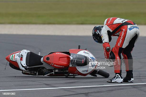 Mahindra Racing rider Miguel Oliveira of Portugal stands by his bike after crashing during the Moto3 race at the Australian Grand Prix at Phillip...