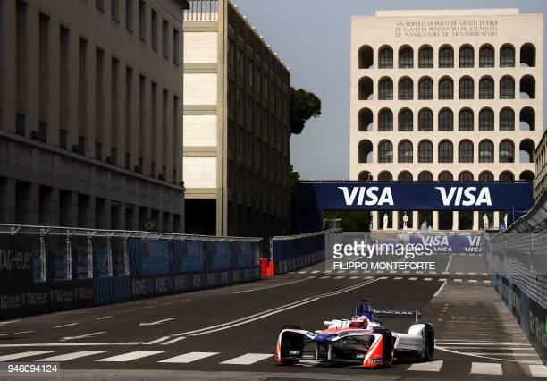 Mahindra racing team Formula E driver Sweden's Felix Rosenqvist steers his car past the Palazzo della Civilta Italiana during practice prior to the...