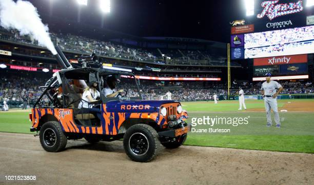 Mahindra Roxor utility vehicle with a mounted turret blasts souvenir balls and tshirts into the crowd during a game between the Detroit Tigers and...