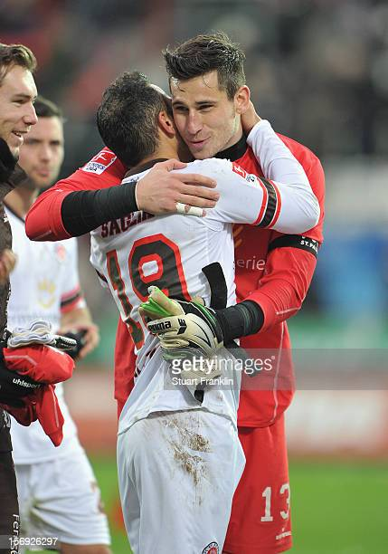 Mahir Saglik celebrates with Philipp Tschauner of St Pauli at the end of the second Bundesliga match between FC St Pauli and MSV Duisburg at...