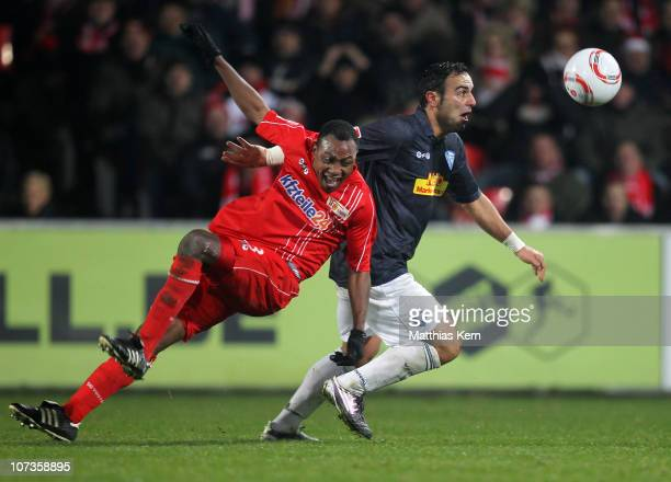 Mahir Saglik of Bochum battles for the ball with Macchambes YoungaMouhani of Berlin during the Second Bundesliga match between 1FC Union Berlin and...