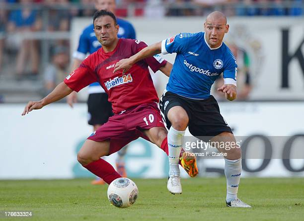 Mahir Saglik of Paderborn and Philipp Riese of Bielefeld fight for the ball during the Second Bundesliga match between Arminia Bielefeld and SC...
