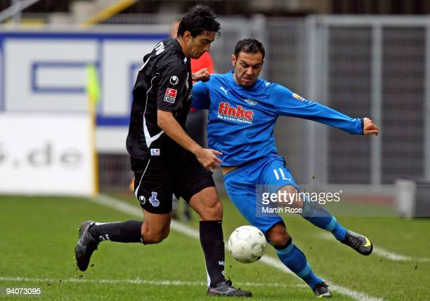 Mahir Saglik of Paderborn and Tiago of Duisburg battle for the ball during the Second Bundesliga match between SC Paderborn and MSV Duisburg at the...