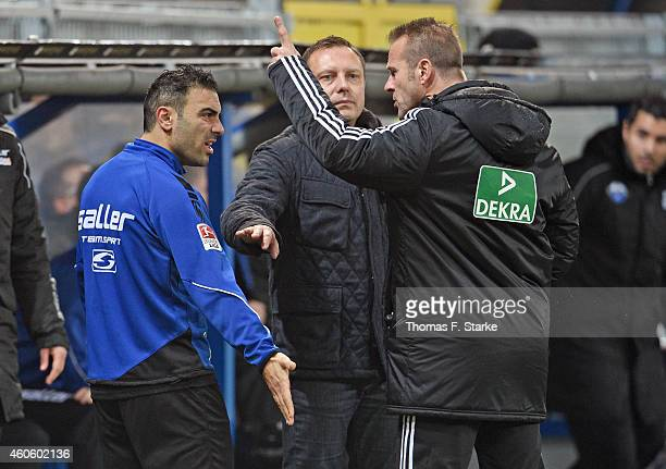 Mahir Saglik of Paderborn argues with fourth official Peter Gagelmann while head coach Andre Breitenreiter of Paderborn steps in during the...