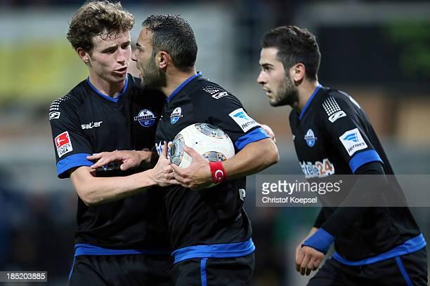 Mahir Saglik of Paderborn celebrates the first goal with Patrick Ziegler L9 and Mario Vrancic of Paderborn during the Second Bundesliga match between...