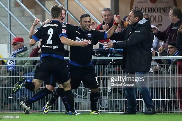 Mahir Saglik of Paderborn celebrates the third goal with Patrick Ziegler Uwe Huenemeier and head coach Andre Breitenreiter of Paderborn during the...