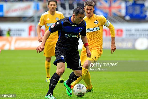 Mahir Saglik of Paderborn plays the ball during the match between SC Paderborn and VFR Aalen at Benteler Arena on May 11 2014 in Paderborn Germany