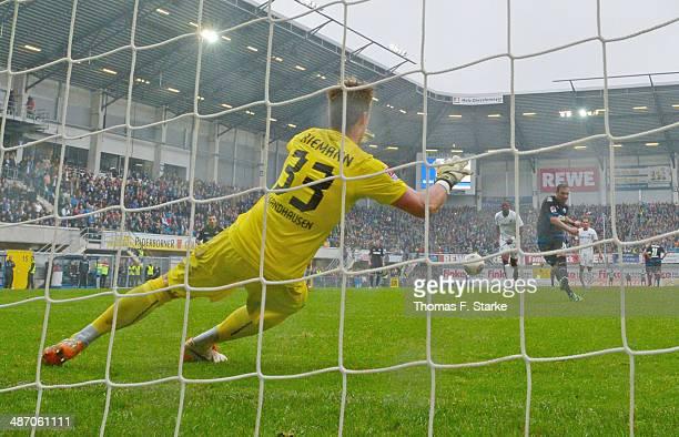 Mahir Saglik of Paderborn scores a penalty against goalkeeper Manuel Riemann of Sandhausen during the Second Bundesliga match between SC Paderborn...