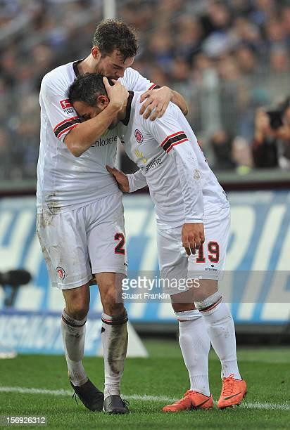 Mahir Saglik of St Pauli celebrates scoring the fourth goal with Akaki Gogia during the second Bundesliga match between FC St Pauli and MSV Duisburg...