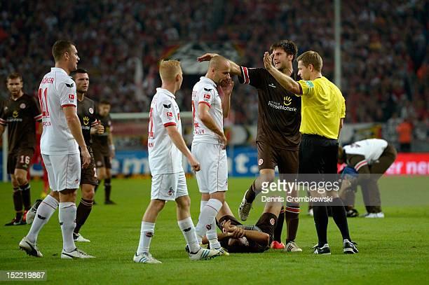 Mahir Saglik of St Pauli lies on the pitch during the Second Bundesliga match between 1 FC Koeln and FC St Pauli at RheinEnergieStadion on September...