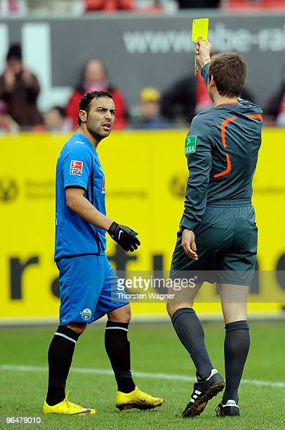 Mahir Saglik shows the yello card from referee Frank Willenborg of Paderborn during the Second Bundesliga match between 1FC Kaiserslautern and SC...