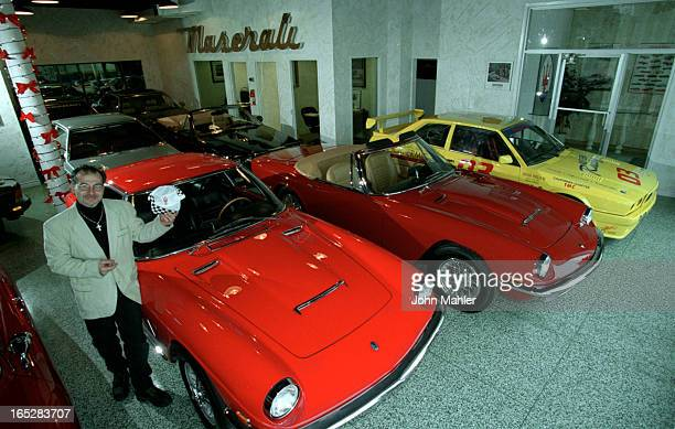 Robert Hanna in his showroom with Maserati's Bright red car on left is a 68 Mistral Coupe It has a 4 litre striaght 6 cyclinder engine twin plugs...