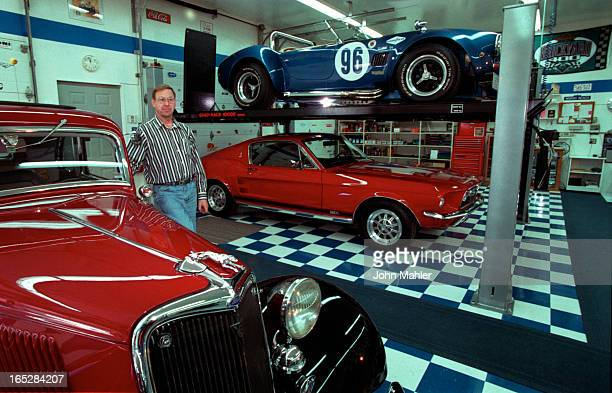 Ted Scholten in his tiled garage with Shelby Cobra kit car he built and his Mustang 289 GTA underneath. Nex to him is his 32 Ford Hot Rod, it has a...