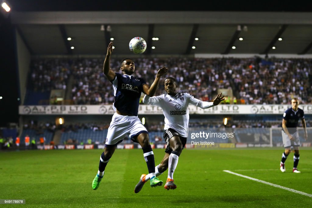 Mahlon Romeo of Millwall battles for the ball with Ryan Sessegnon of Fulham during the Sky Bet Championship match between Millwall and Fulham at The Den on April 20, 2018 in London, England.
