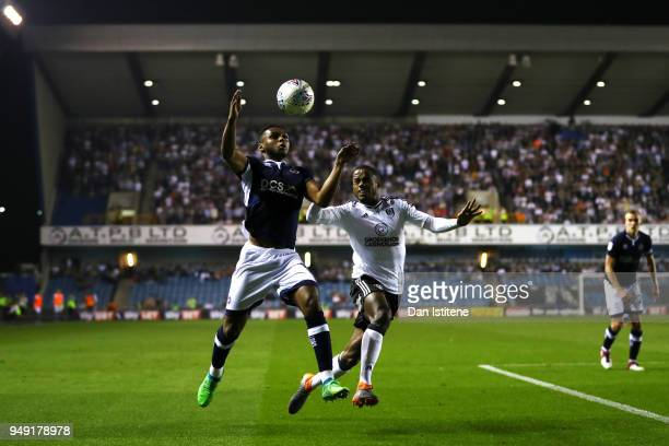 Mahlon Romeo of Millwall battles for the ball with Ryan Sessegnon of Fulham during the Sky Bet Championship match between Millwall and Fulham at The...