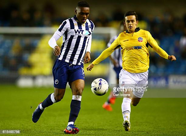 Mahlon Romeo of Millwall battles for the ball with Zach Clough of Bolton Wanderers during the Sky Bet League One match between Millwall and Bolton...