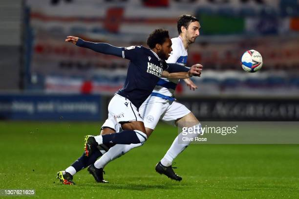 Mahlon Romeo of Millwall FC and Lee Wallace of Queens Park Rangers battle for the ball during the Sky Bet Championship match between Queens Park...