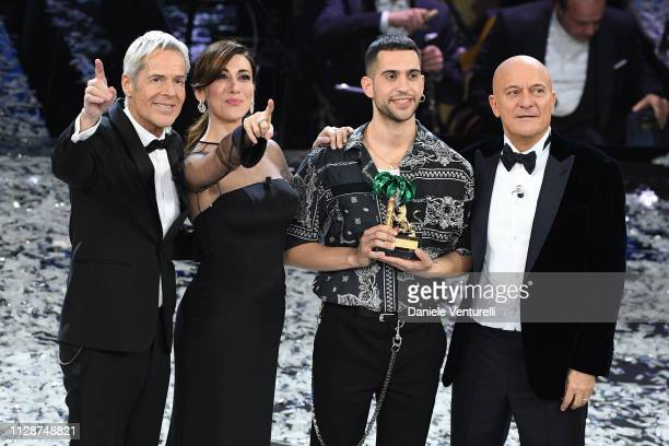 Mahmood with his winner's award with hosts Claudio Baglioni, Virginia Raffaele and Claudio Bisio on stage during the closing night of the 69th...