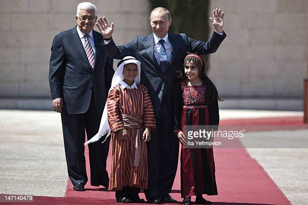 Mahmoud Abbas the President of Palestinian authority welcomes Vladimir Putin the President of Russian Federation together with children during...