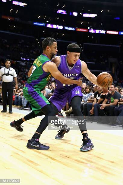 Mahmoud AbdulRauf of 3 Headed Monsters defends against Mike Bibby of Ghost Ballers during week eight of the BIG3 three on three basketball league at...