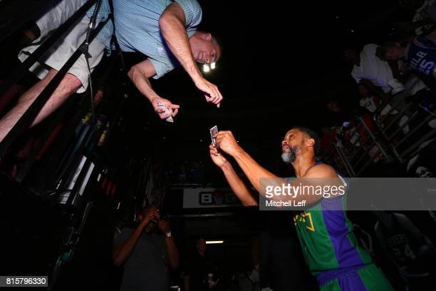 Mahmoud AbdulRauf of 3 Headed Monsters signs autographs during week four of the BIG3 three on three basketball league at Wells Fargo Center on July...