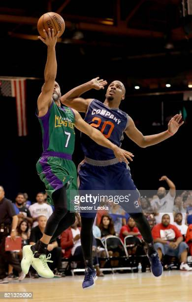 Mahmoud AbdulRauf of the 3 Headed Monsters attempts a shot while being guarded by Andre Owens of 3s Company during week five of the BIG3 three on...