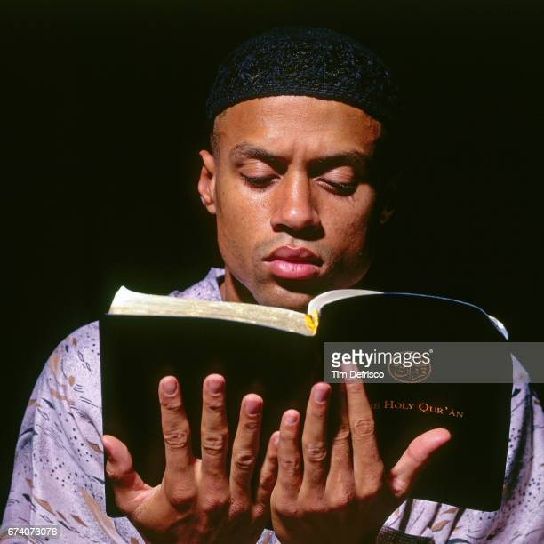 Mahmoud AbdulRauf of the Denver Nuggets reads the Quran circa 1995 in Denver Colorado NOTE TO USER User expressly acknowledges and agrees that by...