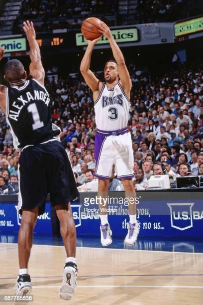 Mahmoud AbdulRauf of the Sacramento Kings shoots against the San Antonio Spurs circa 1996 at Arco Arena in Sacramento California NOTE TO USER User...