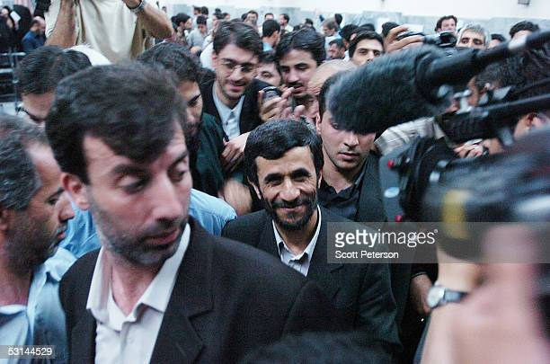 Mahmoud Ahmadinejad the ultraconservative mayor of Tehran who made it into a secondround runoff vote smiles as he is mobbed by journalists after...