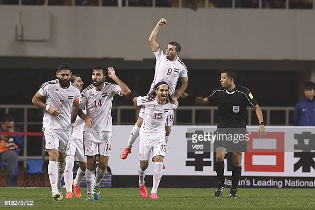 Mahmoud Al Mawas of Syria celebrates with teammates during the 2018 World Cup qualifying group A match between China and Syria at Shanxi Stadium on...