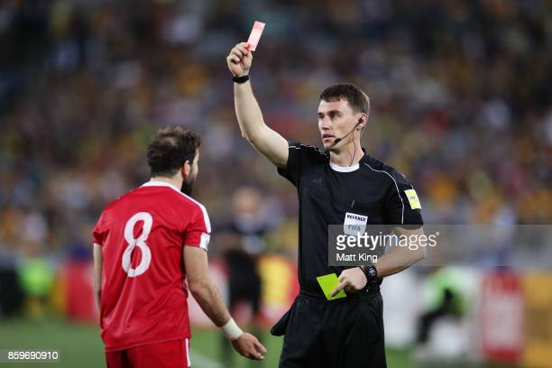 Mahmoud Al Mawas of Syria is given a red card during the 2018 FIFA World Cup Asian Playoff match between the Australian Socceroos and Syria at ANZ...