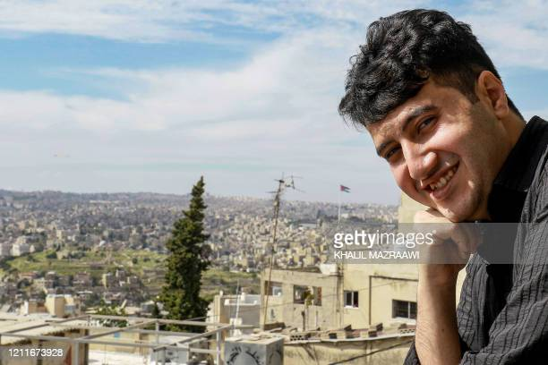 Mahmoud Azzazi studying to become a chef and one of the prize winners of a culture ministry talent contest poses for a picture at home in Jordan's...