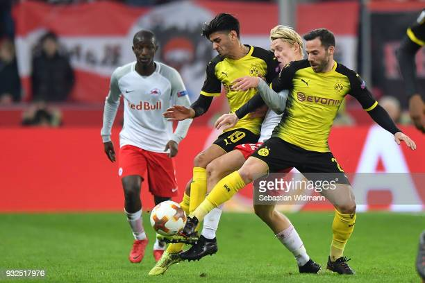 Mahmoud Dahoud and Gonzalo Castro of Dortmund compete with Xaver Schlager of Salzburg for the ball during the UEFA Europa League Round of 16 2nd leg...
