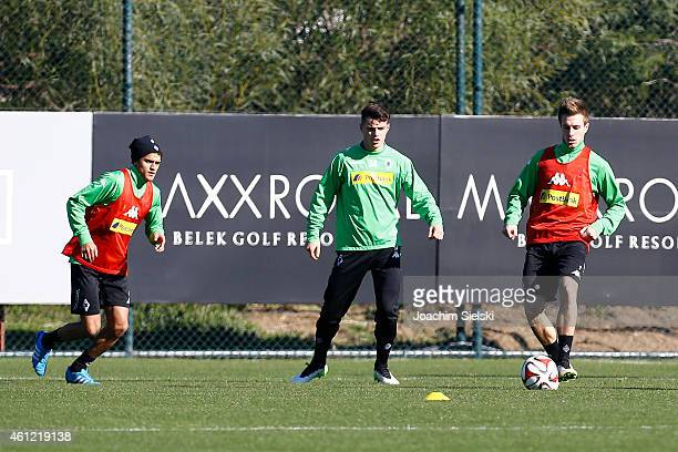 Mahmoud Dahoud Granit Xhaka Patrick Herrmann attends a training session at day two of Borussia Moenchengladbach training camp on January 9 2015 in...