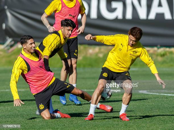 Mahmoud Dahoud of Borussia Dortmund Achraf Hakimi of Borussia Dortmund and Shinji Kagawa of Borussia Dortmund battle for the ball during a training...