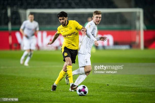 Mahmoud Dahoud of Borussia Dortmund and Christoph Kramer of Borussia Moenchengladbach battle for the ball during the DFB Cup Quarter Final match...